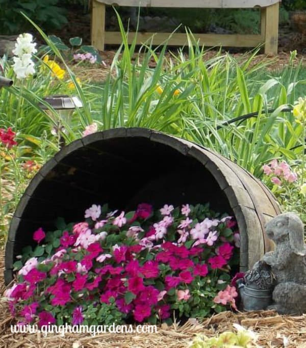 Whiskey barrel filled with impatiens.