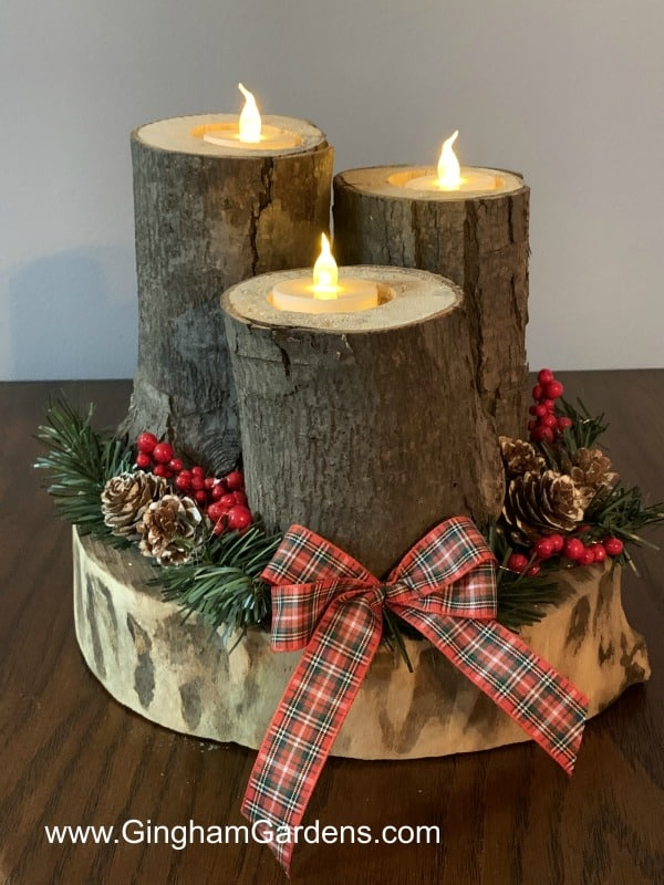 Rustic Centerpiece Using Logs - Just one of the projects included in Festive DIY Projects Made With Tree Branches and Logs