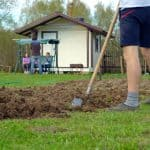 Man digging a new garden bed.