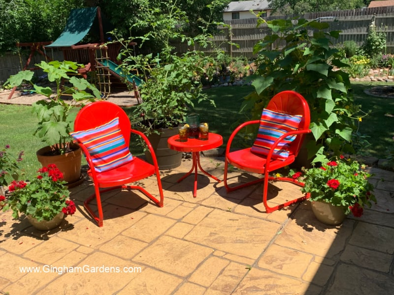 Image of a red bistro set in a garden room