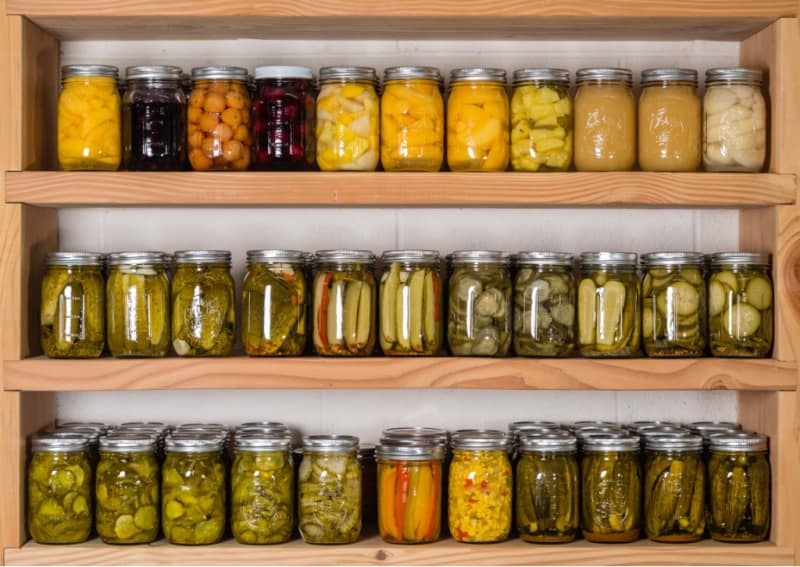 Jars of Canned Produce on Shelves