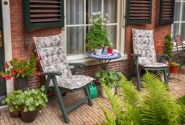 Image of a small patio with flower and plants